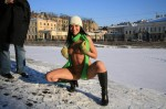 004 150x99 Nude girl in the snow with awesome green scarf