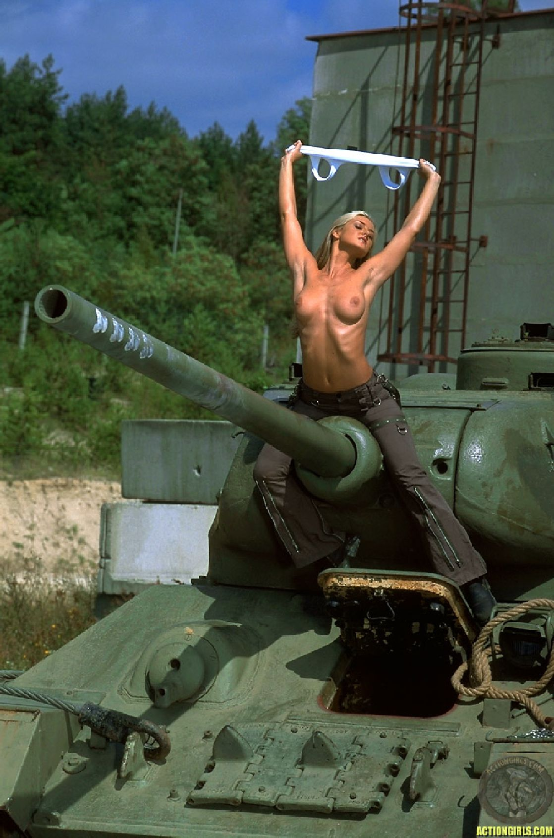http://www.tikiwebgroup.com/tikitumble/wp-content/uploads/sites/15/2009/10/nsfw-topless-tank-girl-with-huge-turret.jpg